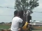 Couple kiss as they ride motorbike at 50mph.